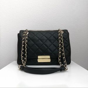Quilted black and gold handbag